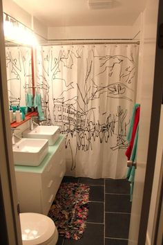 I should totally paint a shower curtain!... I love the double sinks in a tight spot.