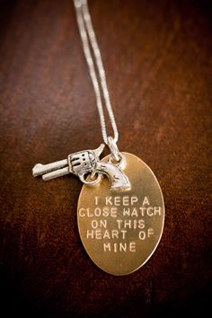 Johnny Cash quote on a necklace with a teeny little six-shooter. Want!
