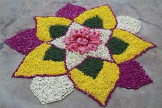 Big list Flower Rangoli Designs ideas and pictures for this ganesh chaturthi or any other Indian festivals. Learn flower rangoli designs for competition with flowers. Simple Rangoli Designs Images, Small Rangoli Design, Rangoli Patterns, Rangoli Designs Diwali, Diwali Rangoli, Rangoli Designs With Dots, Beautiful Rangoli Designs, Kolam Designs, Indian Rangoli