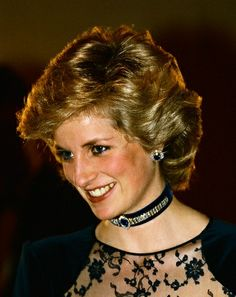 Diana wore the necklace and earrings often, and occasionally the bracelet. She used the stones from the watch and ring to make completely new pieces of jewelry. The oval sapphire from the ring was set in the diamond frame from the watch and is now the centerpiece on a choker of midnight-blue velvet. On either side of the sapphire is a chain of small diamonds three rows deep that wrap half way around the choker.