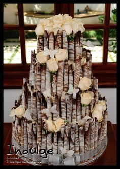 A 'cigarillo' style(?) cake. I like how it looks like tree trunks. And I wouldn't be afraid to cut into it. http://www.indulgecakes.co.za/weddingcake-cassimere.php