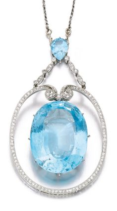 An Edwardian aquamarine and diamond pendant, circa 1910. Suspending an oval aquamarine weighing 61.09 carats, within a frame of circular- and single-cut diamonds, to a surmount similarly set with a pear-shaped aquamarine, to a detachable fine link chain, length approximately 400mm. #Edwardian #pendant