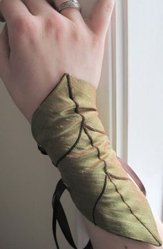 From AncientGrove on Etsy, little leafy arm cuffs!