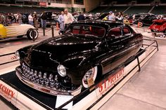 1951 Mercury leadsled chopped sedan with suicide rear doors in a flawless gloss black paint job with frenched headlights, a DeSoto grille and a red interior. Pic 1