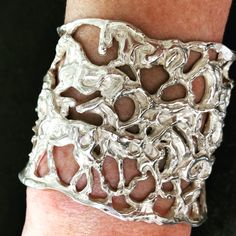 One of a kind lost wax casting in sterling silver. This unique cuff bracelet depicts a herd of horses originally made with dripped wax by Marcela Ganly Lost Wax Casting, Sterling Silver Cuff Bracelet, Belt Buckles, Cuff Bracelets, Cuffs, Skull, Horses, Tattoos, Unique