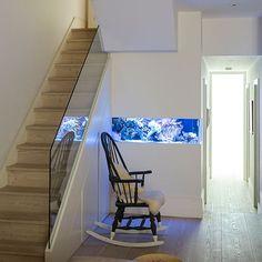 Modern white hallway with rocking chair | Hallway decorating | housetohome.co.uk