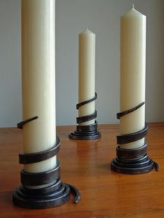 Wrap candlesticks By james | Published: May 19, 2010 A beautifully simple design where one long taper forms the candlestick, polished and lacquered with a stamp (makers mark) in the base.