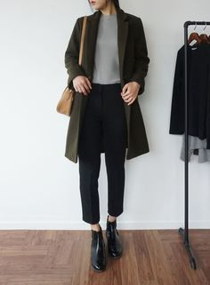 navy coat, grey crew neck t-shirt, black suit pants, black heel boots, low messy bun, black handbag