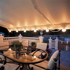 outdoor lights on retractable awning backyard-ideas
