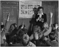 February, 1943. Catherine M. Rooney, 6th grade teacher instructs her pupils on how to use War Ration Book Two. During the war, many items were rationed because they were in short supply, and rationing avoided shortages, and made sure that not only the rich would be able to get essential goods.