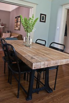 Industrial kitchen table. -- this looks like the kind of table I need. my boys could NOT destroy it. :) it looks super solid.