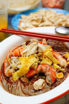 Laksa Sarawak  -vermicelli with a base of sambal belacan,sour tamarind,garlic,galangal,lemon grass and coconut milk topped with omelette strips,chicken strips,prawns,fresh coriander,bean sprouts and optional,lime.