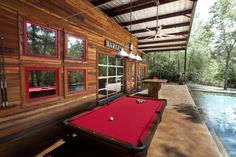 Pool House Bar   This is a splendid bar area with an outdoor pool table. The red pool ...