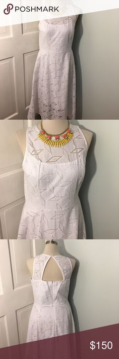 "WHBM NWT White polyester cotton dress.  Stunning NWT Beautiful WHBM White 73% cotton 37% polyester dress.  100% cotton lining.  Dress has cutout netting pattern throughout.  Keyhole and zipper closure in back.  Measures 43 1/2"" in length/ 161/2"" waist/ 18 1/2"" bust line.  Very pretty summer dress White House Black Market Dresses Midi"