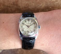 """This 1920's cushion-shape Marconi Rolex has a """"Snowite"""" case, a chrome-plated nickel-based material. """"Marconi"""" was the fourth brand name registered by Hans Wilsdorf, in 1911, and was named after Gugeliemo Marconi who sent radio waves across the Atlantic in 1901 and was later awarded a Nobel Prize. Unfortunately, the first Marconi watches were not released until the 1920's, and by that time Marconi's relevance as a scientific figure had waned (Store Inventory# 9102)."""