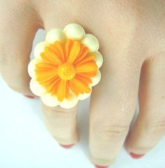 Cream oval framed orange daisy adjustable ring by bunnyboutique, $19.00