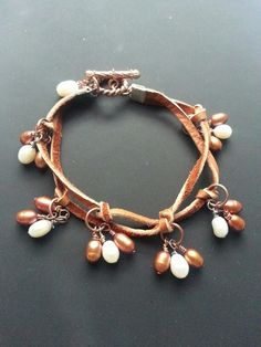 Double strand leather bracelet with bronze and white pearls. $35