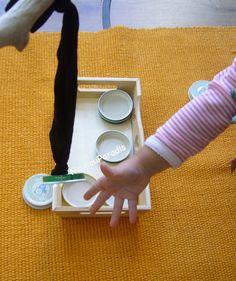 Baby pêche des couvercles (de petits pots bb)