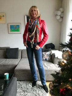 red leather jacket, multi coloured scarf, jeans, black suede booties