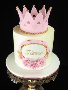 A princess cake for a beautiful little girl. This is a pink vanilla cake with meringue buttercream inside and out and decorated with fondant flowers and crown.