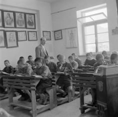 Greece, teacher lecturing to boys in classroom in Métsovon