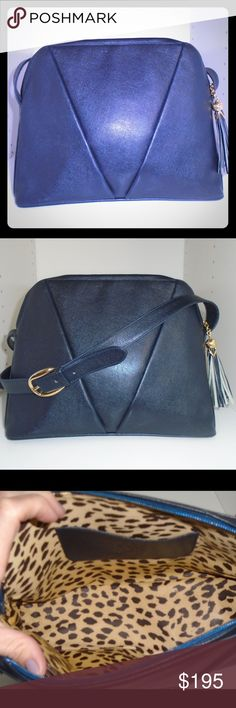 "Vintage Valentino Couture Shoulder Purse Stunning Navy vintage Valentino. Leather is texture and AMAZING leopard interior. Gilt medal and leather tussle create vivid zipper. No signs of wear on bottom, purse has been very well maintained. Can be used as shoulder purse or cross body. Measures about 12"" in length and 9"" height. Made in Italy. Valentino Bags Shoulder Bags"