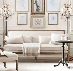 Add centre chandelier on formal living room. Linen sofa, have multiple paintings on wall. Ivory Living Room, Home Living Room, Living Room Decor, Living Spaces, Glamour Décor, White Rooms, White Walls, Inspired Homes, Beautiful Interiors