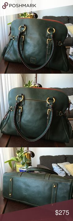 """Dooney Bourke Florentine Domed Buckle Satchel--IVY Authentic and gorgeous color for the Fall season! This color is no longer available on Dooney's site! Dooney & Bourke Domed Buckle Satchel in Ivy (dark forest green). Huge bag! Can use it as a weekender if you want to! Excellent condition, minor blemishes and scratches as is common in these bags. Very clean inside, the key keeper seems to need a stitch or two, I didn't notice the fraying before until now. Measurements: 15""""L X 10""""H X 6""""D…"""