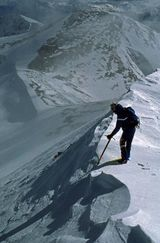 8 Tips for Safe Snow Travel: A climber probes a cornice with his ice axe on Mount Sherman in the Colorado Rockies.