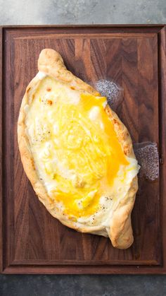 Khachapuri Recipe with video instructions: You'll want to dive face-first into this swimming pool made of bread and cheese. Ingredients: 1 cup milk, 2 packets yeast, teaspoon plus 1 tablespoon sugar, Breakfast And Brunch, Appetizer Dips, Appetizer Recipes, Khachapuri Recipe, Yummy Food, Tasty, Feta, Cooking Recipes, Cooking Tv