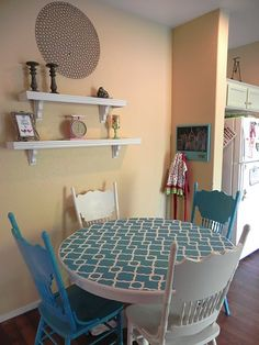 This is SOOOO Cute!  You could paint those old chairs that you had two different colors and do the stencil on the top of Mom's table.  This would be Gorgeous in your basement, and would work for a good game/food table