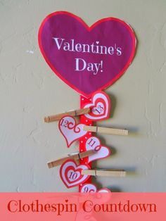 Clothespin Valentine's Day Countdown.  Comes with free printables so you can make your own:: pinningwithpurpose