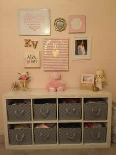 Bookshelf from Ikea. Baskets from Homegoods. Most decor from Hobby Lobby.