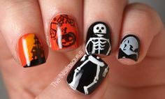 Halloween nail art :) ahh the skeleton on the thumb and ring finger is such a cute idea!
