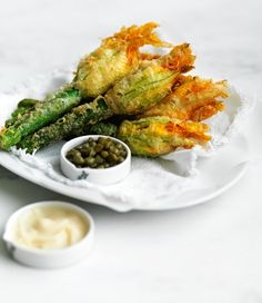 Deliciously sweet, the zucchini flower's fragility adds an elegant twist to any meal. Fried Zucchini Flowers, Zucchini Fries, Zucchini Blossoms, Vegetable Recipes, Vegetarian Recipes, Cooking Recipes, Healthy Recipes, Tempura, Yellow Squash Recipes