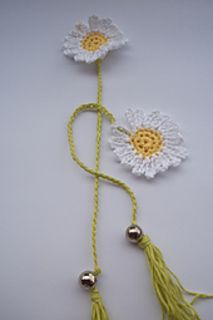 This Book Marker is made to fall over the book as you can see in the picture. Also it can be turned into a keychain, or make 2 of these flowers and connect them buy a chain and make a rear view mirror hang like a pair of dice!