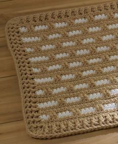 Hearth & Home Rug in Red Heart Super Saver Chunky. Find this pattern to personalize your home at LoveCrochet.Com!