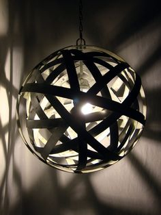 Custom Made Orbits, urban chandelier, recycled wine barrel metal hoops, galvanized steel bands, ceiling light fixture by Stil Novo Design