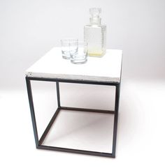 The hand welded frame is powder coated. Powder coating is a technique in which both the frame and the paint are electrically charged during painting and dried in an oven to ensure a very good adhesion. The concrete top is hand poured in a special made mould. The concrete is finished to make it more liquid resistant.