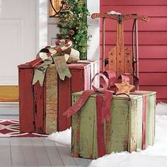 Stack up the gifts in a delightful new way by arranging them in our Artisan Sleigh. Crafted of rustic recycled wood, it looks like an heirloom from great-grandpa's day. It's large enough to be the focal point of your porch or living room d, with a seat for stacking gifts or festooning with your favorite greenery. Not intended to be used as a sled, this is an eye-catching decorative piece that you'll treasure for years.                    Charming decorative sleigh made of recycled wood  ...