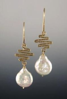 jewelry image of Style: 82573 Limited Edition: White coin pearls with slight drop shape hang from small hand-hammered gold-filled zig-zag shapes. Hand-hammered ear wires. Earring Dimensions: Length: 2 including ear wires Width: 1/2 Gem: White cultured fresh water coin pearl with slight drop shape 16mm x 13mm