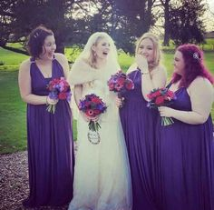 Anemones, calla lilies and roses match these purple dresses and would suit a gothic look