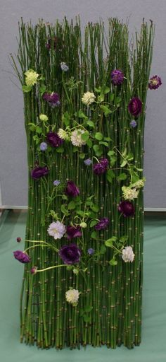 Freestanding flower arrangement. Two of these would be very unique flanking the altar at a contemporary wedding. Think modern/contemporary art museum wedding.