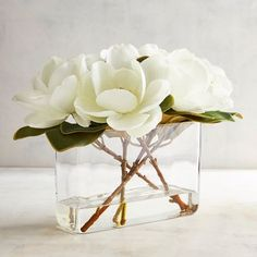 Our Faux Magnolia Arrangement is the soul of simplicity—just stems, perfectly fashioned, in a rectangular glass vase. Yet when paired with so perfect a sense of proportion, the effect is simply stunning. Artificial Flower Arrangements, Artificial Flowers, Floral Arrangements, Home Flowers, Faux Flowers, Glass Flowers, Paper Flowers, Interior Decorating Styles, Decorating Tips
