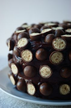 Malteser Cake by poiresauchocolat via thekitchn: Yellow cake with Horlicks, dark chocolate ganache and maltesers! (Wasn't extract of malt Tigger's favorite?)