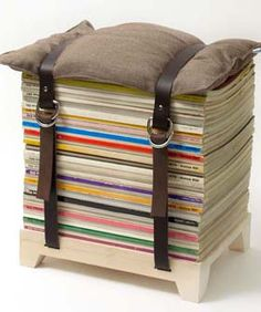 Using a base and two straps one can finally store my magazines.  The cushion on top makes a sitting space.  For less than $185, I think I could make one for myself  AND I HAVE PLENTY OF Magazines.  I like the idea....