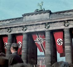MPOWER/// The German War Flag hangs boldly from the central arch of the Brandenburg Gate as part of the grandiose victory celebrations for the German Reich's rapid and unprecedented triumph over France in the Summer of Berlin, German Reich. Modern World History, European History, Propaganda Art, Germany Ww2, Brandenburg Gate, Man Of War, Empire, The Third Reich, Berlin Wall
