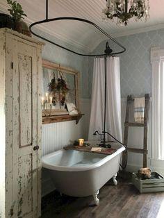 A shabby chic farmhouse bathroom with grey printed wallpaper, a white clawfoot tub, a shabby chic storage unit, a mirror in a wooden frame. Bad Inspiration, Bathroom Inspiration, Vintage Bathrooms, Vintage Bathroom Decor, Farmhouse Bathrooms, Country Bathrooms, Vintage Bathtub, Bohemian Bathroom, Chic Bathrooms