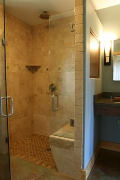 this small master bath maintains ada in the shower with no threshold and a