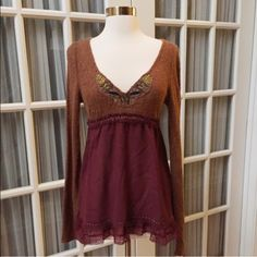 NWOT Beautifully Embellished Free People Top NWOT Beautiful Free People Top.  Mix of material and embroidered detail makes this top stunning.  So many sweet little details!  Delicate thin ribbon tie around back.  Size Small. Free People Tops